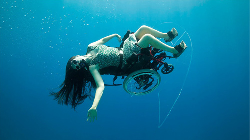 wheelchair scuba diver in action
